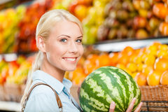 Girl at the shop choosing fruits hands watermelon Stock Photography