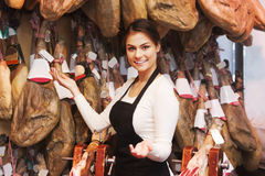 Girl in the shop jamon Stock Images