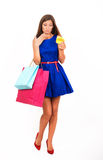 Girl Shopaholic. Studio portrait of a thriftless girl with the empty purse Royalty Free Stock Photography