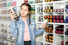 Girl shopping acrylic color spray Royalty Free Stock Images
