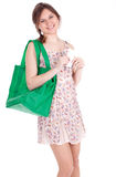 Girl with shopping bag checking purchases list Royalty Free Stock Images