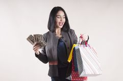 Girl shopping bag dollars studio. Emotions Royalty Free Stock Photo