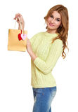 Girl with shopping bag and hearts  dressed jeans and a green sweater posing in studio on white background Stock Photo