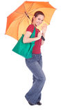 Girl with shopping bag and orange umbrella Royalty Free Stock Image