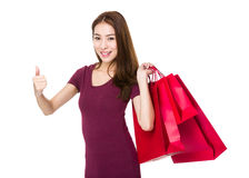 Girl with shopping bag and thumb up Royalty Free Stock Images