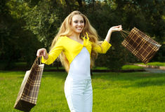 Girl with shopping bags Stock Photos