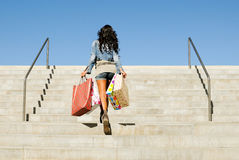 Girl with shopping bags. Attractive young girl with shopping bags in the street Stock Image