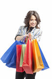 Girl with shopping bags. On white background smiling Royalty Free Stock Image