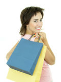 Girl with shopping bags. Happy young woman with shopping bags royalty free stock photos