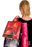 Girl with shopping bags. Girl in black holding shopping bags Royalty Free Stock Image