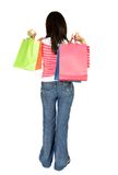 Girl with shopping bags from behind Royalty Free Stock Images