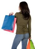 Girl with shopping bags from behind Stock Photos