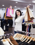 Girl with shopping bags at boutique Stock Image