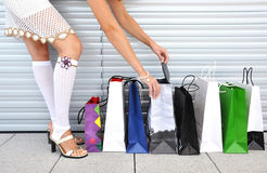 Girl with shopping bags. Girl with a bunch of shopping bags Royalty Free Stock Image