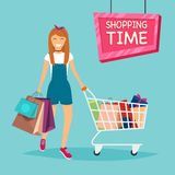 Girl with shopping bags and cart for shopping from the store. Sa Royalty Free Stock Images