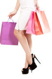 Girl with shopping bags, closeup on beautiful female legs on stilleto stock image