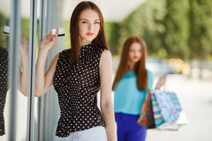 Girl with shopping bags and credit card. Stock Photos