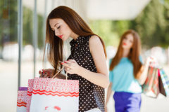 Girl with shopping bags and credit card. Royalty Free Stock Photography