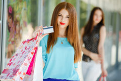 Girl with shopping bags and credit card. Stock Image