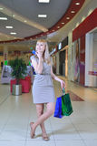Girl with shopping bags and credit cards Royalty Free Stock Image