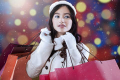 Girl with shopping bags and defocused background Royalty Free Stock Photos