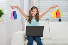 Girl With Shopping Bags And Laptop Stock Photo