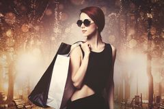 Girl with shopping bags at night street royalty free stock photo