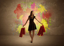 Girl with shopping bags and paint splatter Stock Images