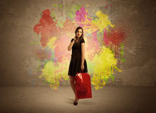 Girl with shopping bags and paint splatter Royalty Free Stock Image