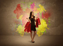 Girl with shopping bags and paint splatter Royalty Free Stock Photos