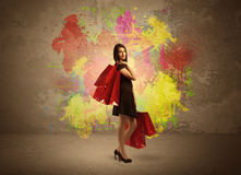 Girl with shopping bags and paint splatter Royalty Free Stock Photography