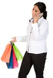 Girl with shopping bags on the phone Stock Images
