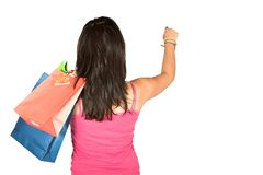 Girl with shopping bags reaching for something Stock Images