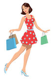 Girl with shopping bags. The girl in a red dress with purchases Royalty Free Stock Images