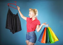 Girl with shopping bags retro style Stock Photography