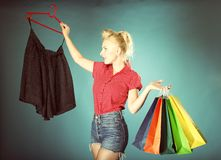 Girl with shopping bags retro style Royalty Free Stock Photography