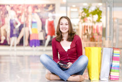 Girl with shopping bags in shop. Stock Photos