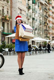Girl with shopping bags at street Royalty Free Stock Photography