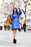 Girl with shopping bags at street Royalty Free Stock Photo