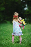 Girl with shopping bags in summer park Royalty Free Stock Photo