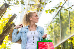 Girl with shopping bags. Girl walking down the street with shopping bags royalty free stock images