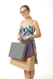 Girl with shopping bags on a white background Royalty Free Stock Photos