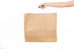 Girl with shopping bags on a white background.  stock image