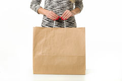 Girl with shopping bags on a white background. Female hand holding shopping bags. Hand of a woman holding many white shopping bags. Isolated on white Stock Photo