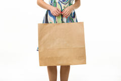 Girl with shopping bags on a white background. Female hand holding shopping bags. Hand of a woman holding many white shopping bags. Isolated on white Royalty Free Stock Photography