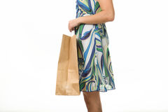 Girl with shopping bags on a white background. Female hand holding shopping bags. Hand of a woman holding many white shopping bags. Isolated on white Royalty Free Stock Images