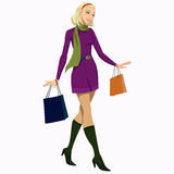 Girl with shopping bags. Young beautiful blonde Woman with shopping bags Royalty Free Stock Photography