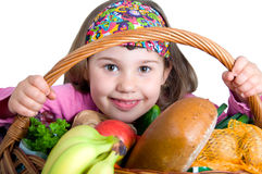 Girl with shopping basket Royalty Free Stock Image