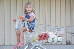 Girl with shopping basket in supermaket Stock Photography