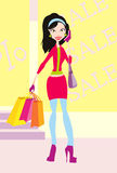 Girl is shopping in big sale. Happy attractive girl is carring many purchases from mall Royalty Free Stock Photos